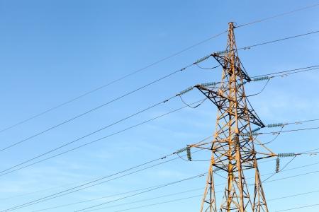 Electricity pylon over blue sky photo