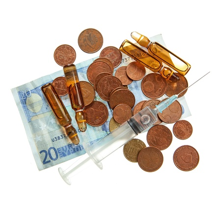 Syringe, drugs ampules. coins and twenty euro banknote isolated over white Stock Photo - 19260854