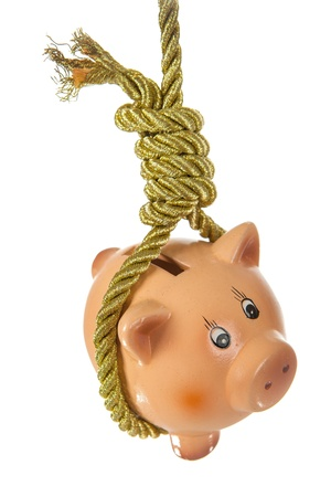 Piggy bank hanging on golden rope in hangmans noose  photo