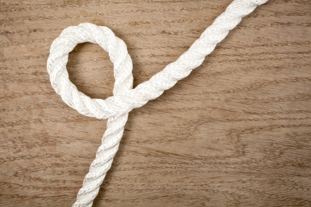 Nylon rope loop on a brown wooden background Stock Photo - 19926345