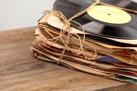 Stack of old vinyl records tied with rope  photo