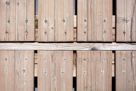 Unpainted wooden fence planks photo