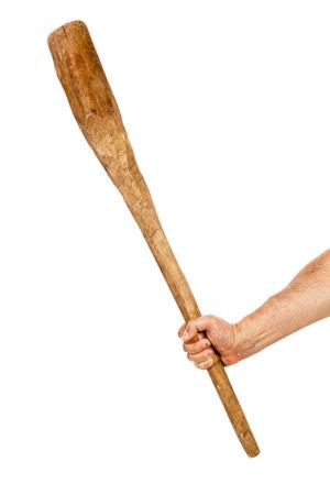 a cudgel: Man hand holding a wooden cudgel