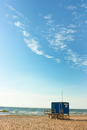 baywatch: A baywatch tower by the sea with bright blue sky