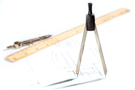 Drawing tools with drawing on white. Shallow depth of field Stock Photo - 24606619
