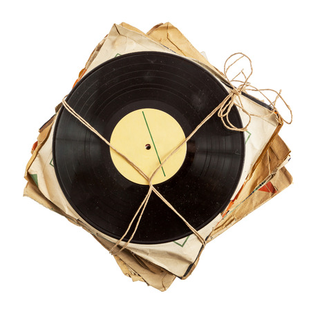 Stack of old vinyl records in paper covers