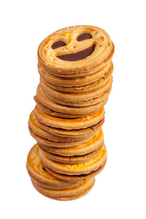 Stack of round cookies with chocolate smiling face isolated over white photo