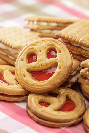 Smiling cookie face on a table photo