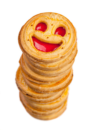 Stack of round cookies with red jelly smiling face isolated over white photo