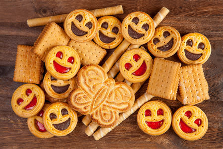 tubules: Sweet tubules, butterfly and smiling faces cookies on a brown table