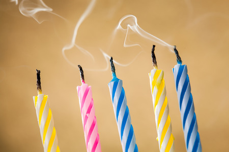 blow out: Five blow out candles over yellow background