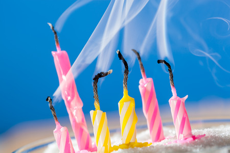 extinct: Six extinct birthday candles over blue background