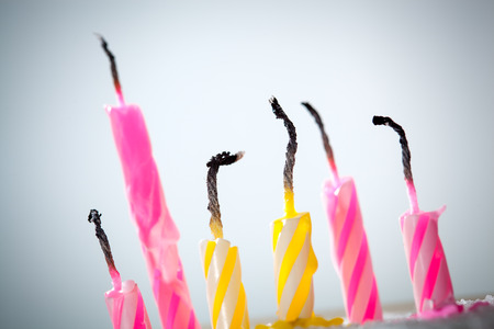 Six blow out candles over grey background. Shallow depth of field, selective focus photo