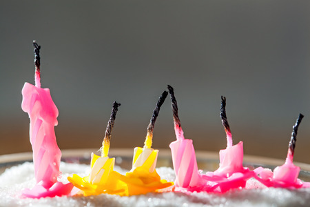blow out: Six blow out candles over grey background. Shallow depth of field, selective focus Stock Photo