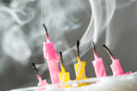 burned out: Six blow out candles over grey background. Shallow depth of field, selective focus Stock Photo