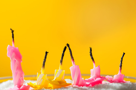 blow out: Six blow out candles over yellow background. Shallow depth of field, selective focus Stock Photo