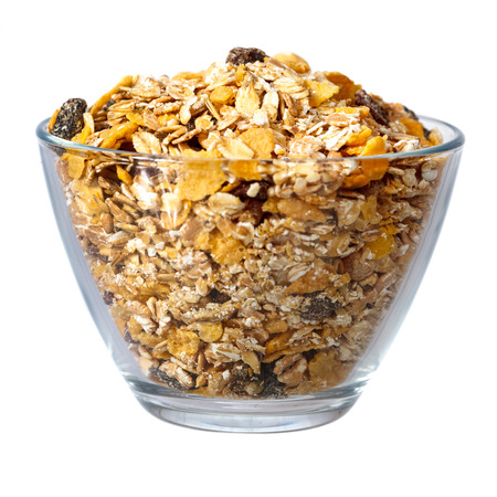 Muesli in glass bowl isolated over white background photo