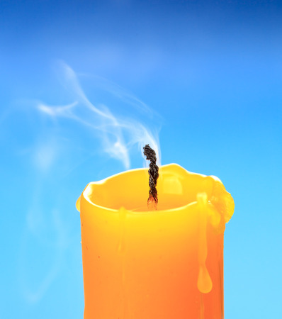 extinct: Extinct candle over blue background