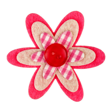 Handmade flower made of sewing button and pieces of fabric isolated on white photo
