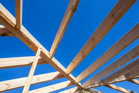 rafters: Rafters over blue bright sky background
