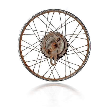 Dirty rusty old spoked motorcycle rim isolated over white