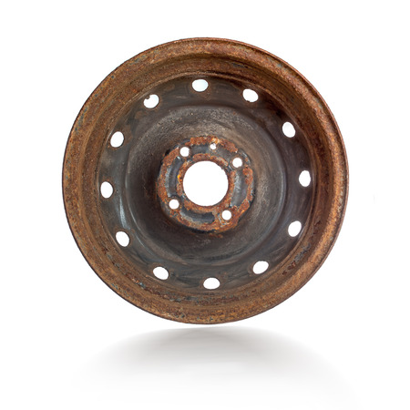 Rusty steel rim isolated over white background photo