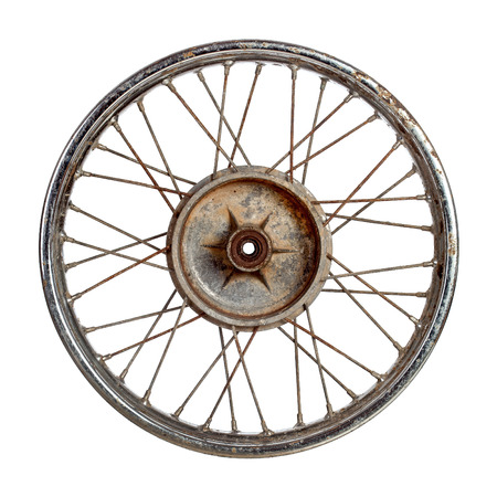 Dirty old spoked motorcycle rim isolated over white Stock Photo