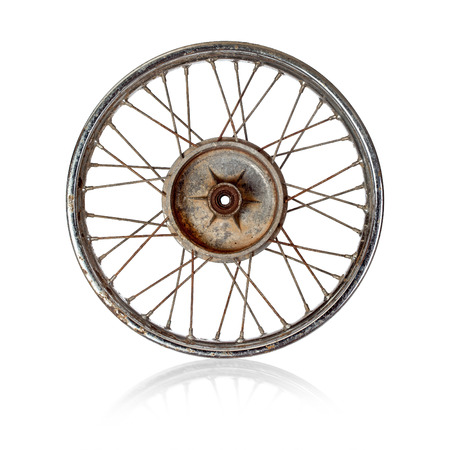 spoked: Dirty old spoked motorcycle rim on white backgrouind Stock Photo