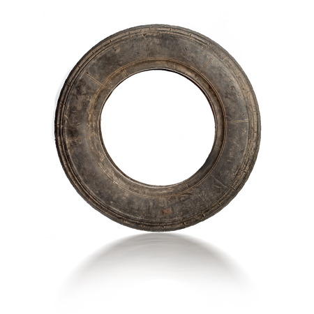 pneu: Small dirty old tire isolated over white Stock Photo