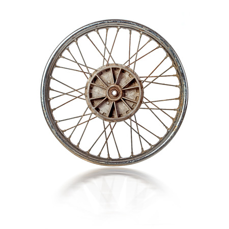 spoked: Dirty old spoked motorcycle rim isolated over white Stock Photo