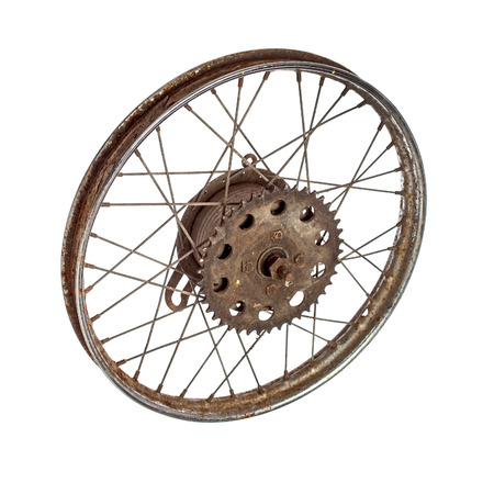 Dirty rusty old spoked motorcycle rim on white backgrouind Stock Photo