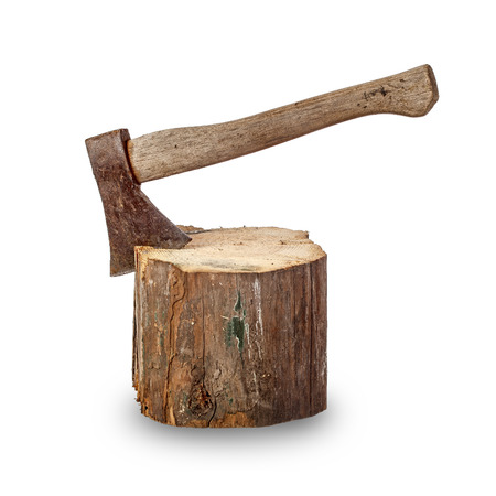 Old axe stuck in log over white background photo