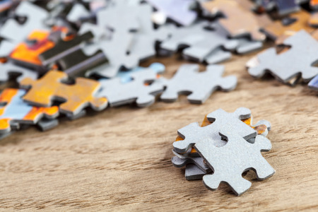 Closeup of jigsaw puzzle pieces on a table