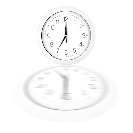 seven o'clock: Clock face showing seven oclock over white background with reflection