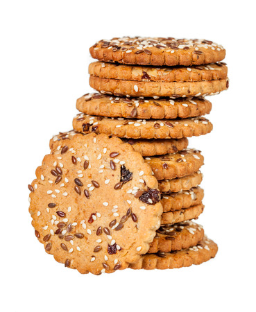 sesame cracker: Stack of round cookies with sesame and flax seeds isolated over white background