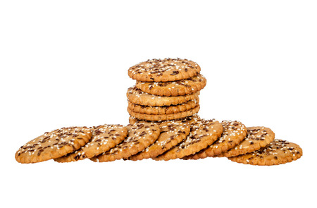 sesame cracker: Stack and pile of round cookies with sesame and flax seeds isolated over white background.