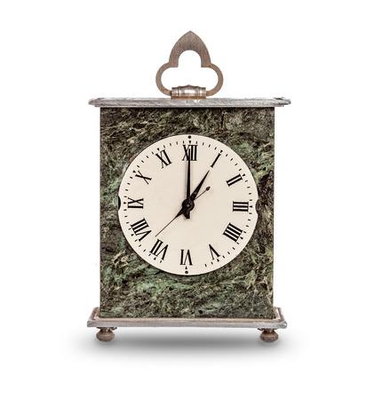 mantel: Mantel clock showing one oclock on white background
