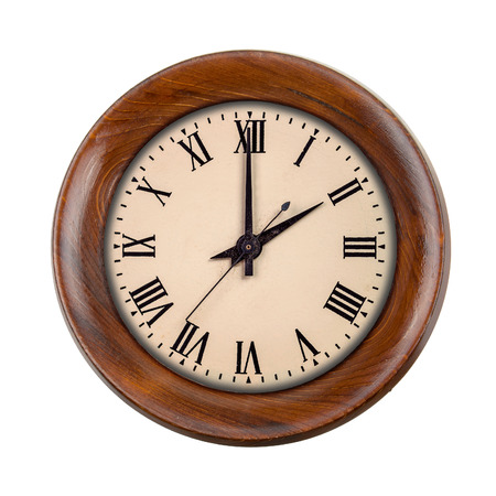Vintage clockface showing two oclock in wooden frame isolated over white photo