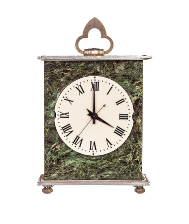 mantel: Four oclock on mantel clock isolated on white background Stock Photo