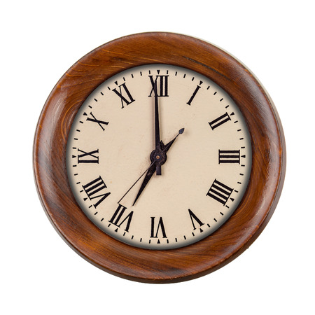 seven o'clock: Vintage clock face showing seven oclock in wooden frame isolated over white Stock Photo