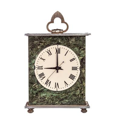 mantel: Nine oclock on isolated mantel clock on white background Stock Photo