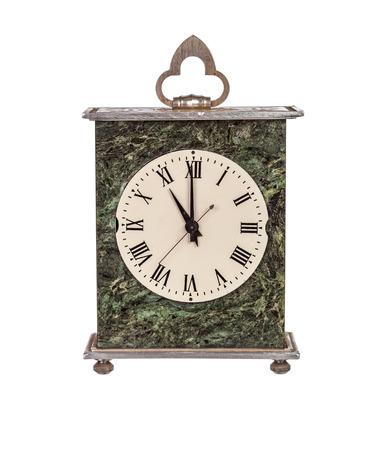 mantel: Eleven oclock on isolated mantel clock on white background Stock Photo