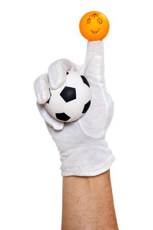glove puppet: Finger puppet holding football ball over white