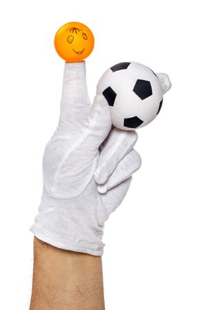 glove puppet: Finger puppet holding football ball over white background Stock Photo