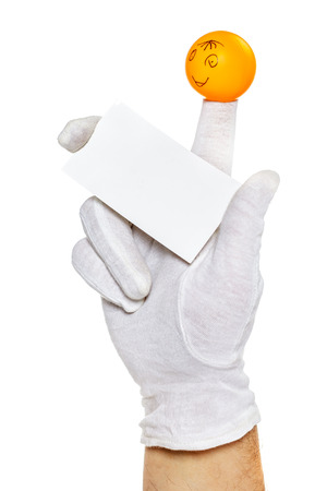 glove puppet: Smiling finger puppet holding empty card with copy space Stock Photo