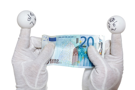 twenty euro banknote: Two finger puppets with angry faces expressions pulling twenty euro banknote