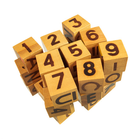 Stacked of wooden blocks with numbers over white background photo
