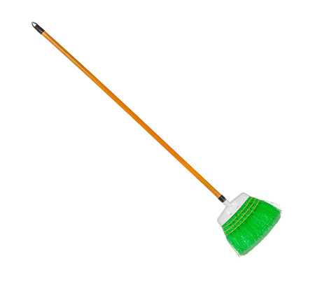 broom handle: Green plastic broom with log brown handle isolated over white