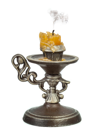 wick: Candlestick with extinct candle and smoke over black wick isolated over white background Stock Photo