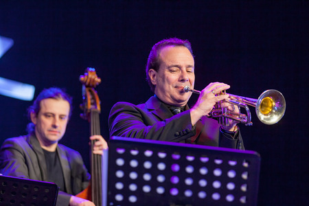 bass player: KAUNAS, LITHUANIA - APRIL 24, 2015: Double bass player Pawel Panta and trumpetist Gary Guthman perform at the stage of Kaunas Jazz festival as a members of Wlodek Pawlik Project.